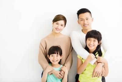Family of dental patients with dental fillings in Champaign, IL